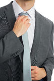 Close up of businessman adjusting blue tie Stock Photo