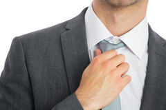 Close up of businessman adjusting tie Stock Photography