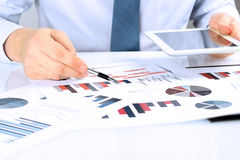 Close-up Of Businessman Analyzing Graph On Digital Tablet Stock Photos