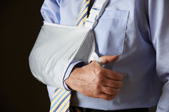 Close Up Of Businessman With Arm In Sling Stock Images