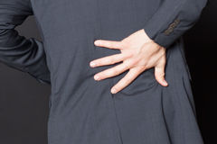 Close-up of businessman with back pain royalty free stock photos