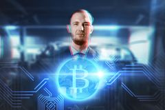 Close up of businessman with bitcoin hologram. Cryptocurrency, finance and business concept - close up of businessman with virtual bitcoin symbol hologram over Royalty Free Stock Image
