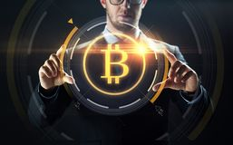 Close up of businessman with bitcoin hologram Royalty Free Stock Images