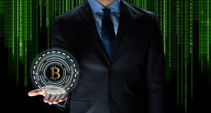 Close up of businessman with bitcoin hologram Royalty Free Stock Photography