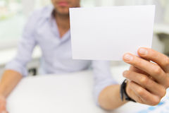 Close up of businessman with blank paper at office Royalty Free Stock Photography