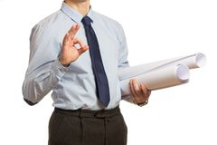 Businessman in a blue shirt and a tie with documents showing ok royalty free stock photos