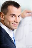 Close up of businessman with blueprint Stock Photography