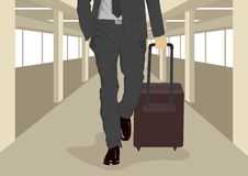 Close up of businessman carrying suitcase while walking at international airport. Close up of businessman carrying a suitcase while walking at international Royalty Free Stock Image