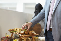 Close Up Of Businessman At Conference Lunch Buffet stock photography