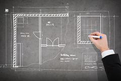 Close up of businessman drawing blueprint Royalty Free Stock Image
