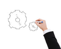 Close up of businessman drawing cogwheel Stock Photos
