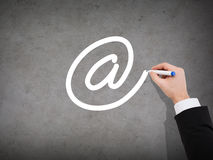 Close up of businessman drawing e-mail sign Stock Image