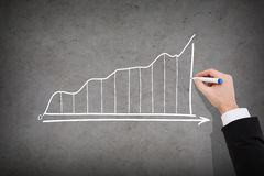 Close up of businessman drawing growing graph Stock Photo