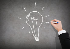 Close up of businessman drawing light bulb Royalty Free Stock Image