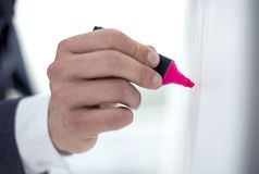 Close up.businessman draws a red marker on the flipchart. Business concept royalty free stock photo