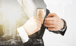 Close up of businessman with euro money Royalty Free Stock Image
