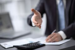 Close up. businessman extending his hand to business partner.  royalty free stock images