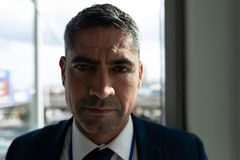 Close-up of businessman face looking at camera in office royalty free stock photo