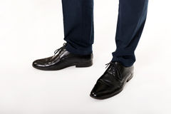 Close-up of businessman feet in black boots Stock Image