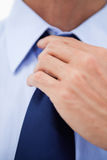 Close up of a businessman fixing his tie Stock Photo