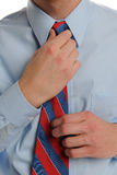 Close up of Businessman fixing his tie Stock Photography