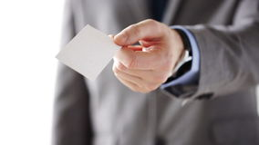 Close up of businessman giving white blank card stock video