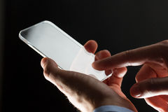 Close up of businessman with glass smartphone Royalty Free Stock Image