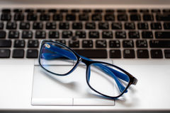 Close-up of businessman glasses on laptop computer., in the coff Royalty Free Stock Photography