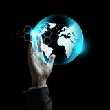 Close up of businessman hand with earth projection Stock Photos