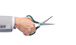 Close up of businessman hand holding scissors. Business, people, and office concept - close up of businessman hand holding scissors Royalty Free Stock Images
