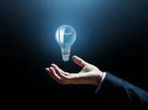 Close up of businessman hand with light bulb Royalty Free Stock Photos