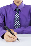 Close up of businessman hand with pen Stock Image