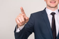 Close-up businessman hand pushing screen on light background Stock Image