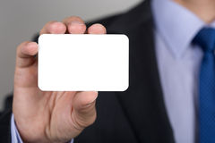 Close up of businessman hand showing business card Stock Images
