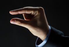Close up of businessman hand showing small size Stock Images