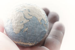Close up of businessman hand showing texture the world concept E Stock Photos