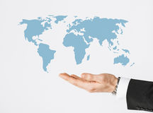 Close up of businessman hand showing world map Royalty Free Stock Photography