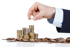 Close up of businessman hand stacking euro coins into increasing Stock Image