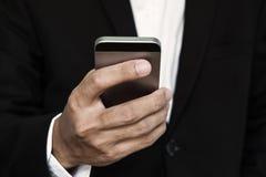 Close-up businessman hand, using smart phone Stock Image