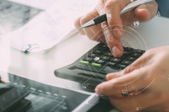 Close up of businessman hand working with finances about cost an Stock Photos