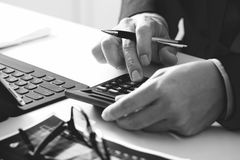 Close up of businessman hand working with finances about cost an Royalty Free Stock Photography