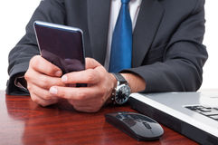 Close-up of businessman hand writing a message. On mobile phone Royalty Free Stock Photos