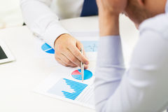 Close up of businessman hands with chart Stock Photos