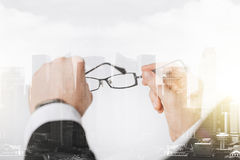 Close up of businessman hands holding glasses Stock Image