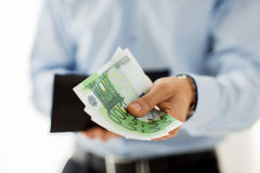Close up of businessman hands holding money Stock Photos