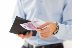 Close up of businessman hands holding money Royalty Free Stock Photography