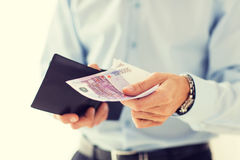 Close up of businessman hands holding money Stock Image