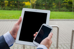 Close up of businessman hands with mobile phone and tablet pc on Royalty Free Stock Photo