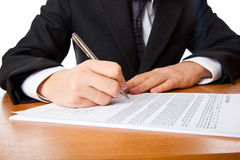 Close up on a businessman hands signing a contract Royalty Free Stock Image