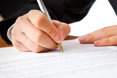 Close up on a businessman hands signing a contract. Isolated on white background Royalty Free Stock Photo